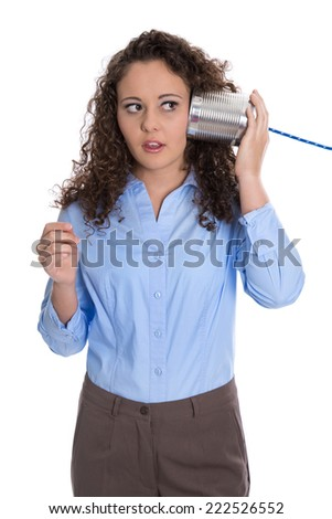 Isolated young businesswoman with tin can phone serious and stunned. - stock photo