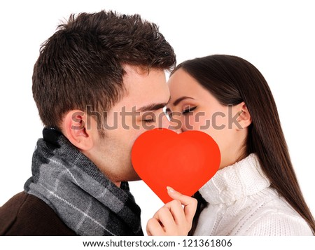 Isolated young casual couple kissing - stock photo