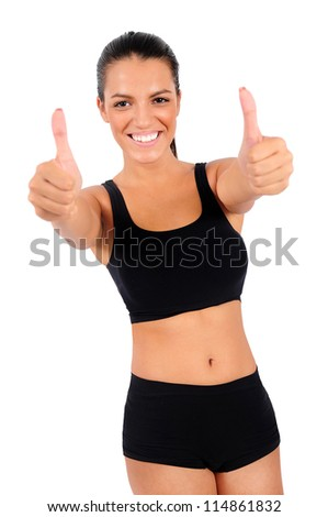 Isolated young fitness woman show ok - stock photo