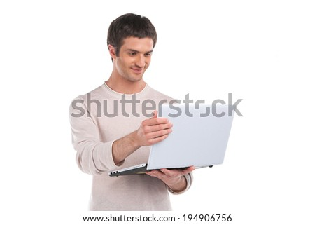 Isolated young handsome man with laptop. Man Holding Laptop On White Background