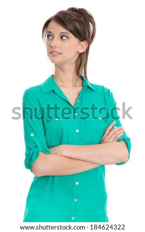 Isolated young student in blouse looking sideways with crossed arms.  - stock photo