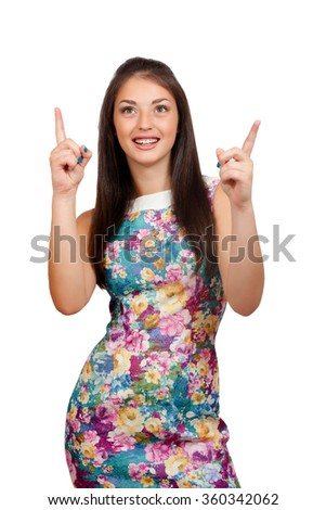 Isolated young woman is presenting or pointing with her finger. - stock photo