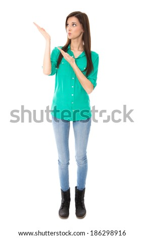 Isolated young woman is presenting  with her hands on white. - stock photo