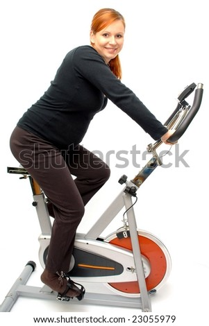 Isolated young woman riding on a bicycle - stock photo