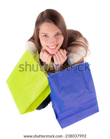 Isolated young woman with shopping bags on white background. - stock photo
