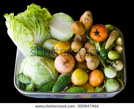 Isolates of various vegetables in a basket, which was preparing to cook a healthy meal. - stock photo