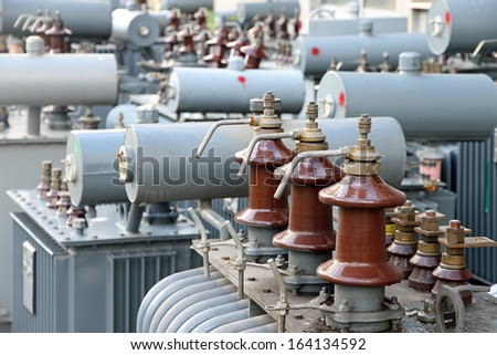 isolators of the three supply phases of a power transformer in a power plant - stock photo