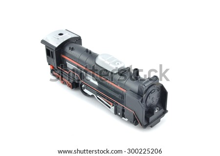 isometric view old and dusty retro look toy black color train head isolated white background - stock photo