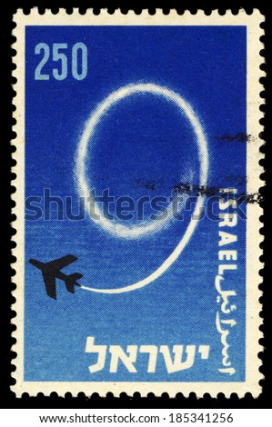 Israel - CIRCA 1957 A stamp printed in Israel honouring the Nineth Independence Day of Israel, shows No.9 written by a jet plane on the sky, circa 1957 - stock photo