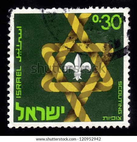 ISRAEL - CIRCA 1968: A stamp printed in Israel shows a stylized Star of David ( Magen David ) dedicated to the 50th anniversary of the Israel  Scouts Federation (HaTzofim) ; series, circa 1968 - stock photo