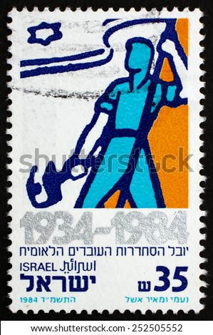ISRAEL - CIRCA 1984: a stamp printed in the Israel shows Worker with Flag, National Labor Federation, 50th Anniversary, circa 1984 - stock photo