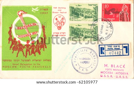 "ISRAEL - CIRCA 1957: A vintage Israeli used envelope showing dancing youth, a torch with inscription on a green background ""Moscow Youth Festivals. Folk Dancing and Drama Festival"", series, circa 1957"