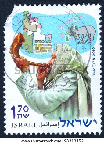 ISRAEL - CIRCA 2010: An used Israeli postage stamp issued in honor of the Rosh Hashanah (Jewish New Year), showing a Jew Blowing a Shofar, series, circa 2010 - stock photo