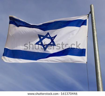 Israel flag in the wind isolated against the sky - stock photo