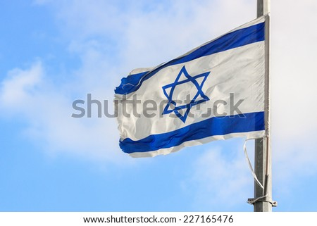 Israel flag waving in the wind - stock photo