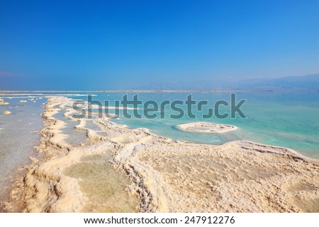 Israel in October. Freakish patterns of the evaporated salt in the Dead Sea. Salt formed long paths with scalloped edges - stock photo