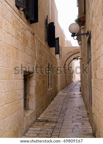 Israel - Jerusalem Old City Alley Jewish quarter made with hand curved stones vertical image - stock photo