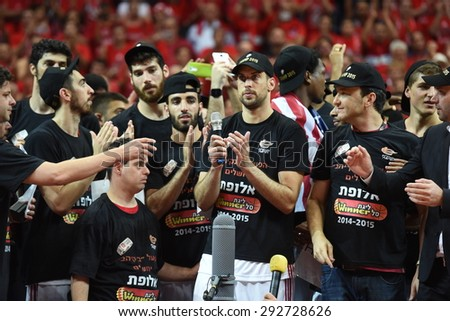 ISRAEL - June 25: Hapoel Jerusalem players celebrate their win of the Israeli league championship in a game between Hapoel Jerusalem and Hapoel Eilat in Pais Arena in Jerusalem on June 25, 2015