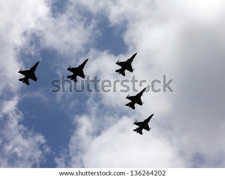 Israeli Air Force airplanes (five jet fighters) at parade in honor of Independence Day - stock photo