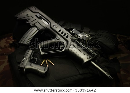 Israeli assault rifles with handgun and ammunition - stock photo