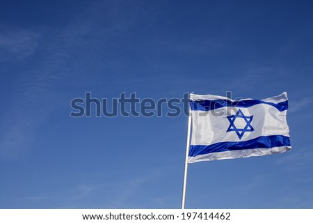 Israeli flag in strong wind - stock photo