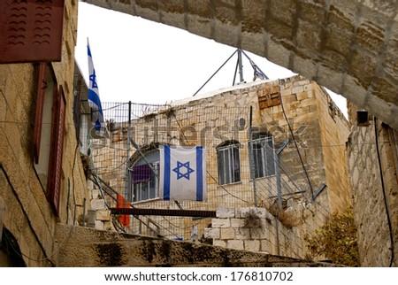Israeli flag in the old town, Jerusalem, Israel - stock photo