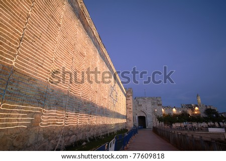 Israeli flag on Jerusalem old city walls. Taken in Israel's independence day - stock photo