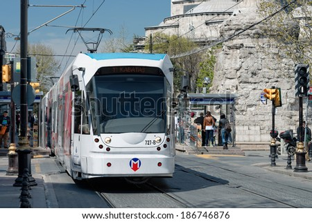 ISTANBUL - APRIL 10: A modern tram on Cemberlitas on April 10, 2014 in Istanbul. Due to increasing traffic & air pollution, Istanbul became one of most polluted city also planned for return of tram. - stock photo