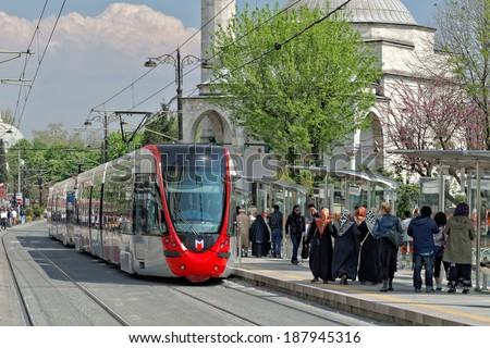 ISTANBUL - APRIL 14: A modern tram on Sultanahmet on April 14, 2014 in Istanbul. Due to increasing traffic & air pollution, Istanbul became one of most polluted city also planned for return of tram. - stock photo