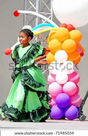 """ISTANBUL - APRIL 23: An unidentified 6 years old Colombian girl in traditional costume perform folk dance on """"National Sovereignty and Children Day"""" festival, April 23, 2010 in Istanbul, Turkey - stock photo"""