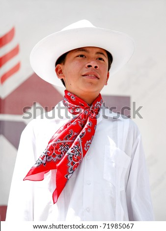 "ISTANBUL - APRIL 23: An unidentified 12 years old Mexican boy in traditional costume perform folk dance on ""National Sovereignty and Children Day"" festival, April 23, 2010 in Istanbul, Turkey - stock photo"