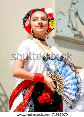 "ISTANBUL - APRIL 23: An unidentified 12 years old Mexican girl in traditional costume perform folk dance on ""National Sovereignty and Children Day"" festival, April 23, 2010 in Istanbul, Turkey - stock photo"