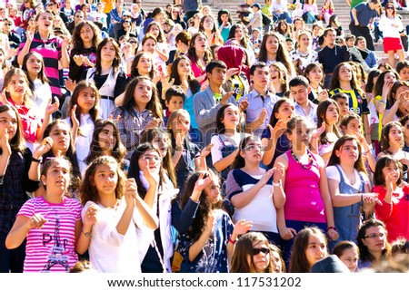 ISTANBUL - APRIL 22: Singer Atiye performs for the children during National Sovereignty and Children Day on April 22, 2012 in Istanbul. Children's Festival was first celebrated in Turkey on 1920. - stock photo