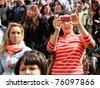 ISTANBUL - APRIL 23: Unidentified music fans records the show during Bengu Erden Concert at Marmara Egitim Kurumlari on April 23, 2011 in Istanbul, Turkey. - stock photo