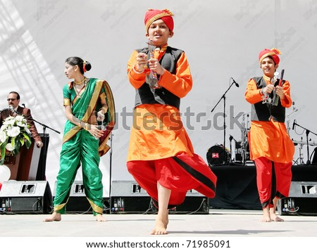 """ISTANBUL - APRIL 23: Unidentified 12 years old Indian children in traditional costume perform folk dance on """"National Sovereignty and Children Day"""" festival, April 23, 2010 in Istanbul, Turkey - stock photo"""