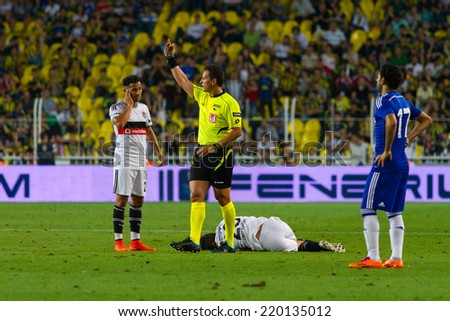 ISTANBUL - AUGUST 08, 2014: Referee calling medical staff in Besiktas vs Chelsea in Soma Charity Tournament in Sukru Saracoglu Stadium. - stock photo