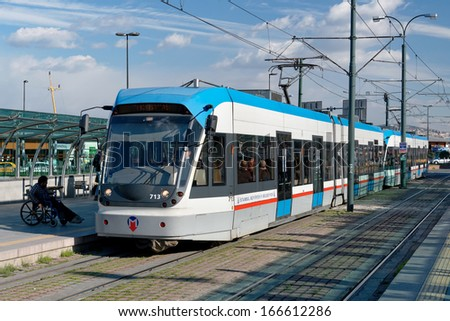 ISTANBUL - DECEMBER 8: A modern tram on Sirkeci on December 8, 2013 in Istanbul. Due to increasing traffic & air pollution, Istanbul became one of most polluted city also planned for return of tram. - stock photo