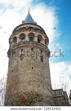 ISTANBUL - DECEMBER 30: Tourists on the top of Galata Tower in Istanbul on December 30, 2012 in Istanbul, Turkey. This is a medieval stone tower one of the city's most striking landmarks. - stock photo