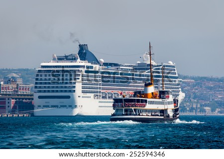 Istanbul ferry sailing in to Bosphorus Sea against cruise ship - stock photo