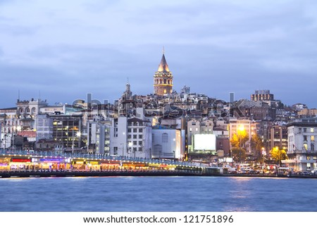 Istanbul, Galata tower and bridge at night - stock photo