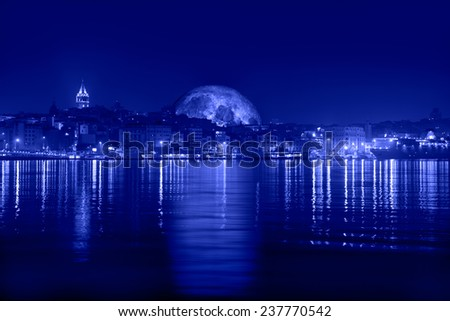 """Istanbul, Galata tower and bridge at night """"Elements of this image furnished by NASA  - stock photo"""