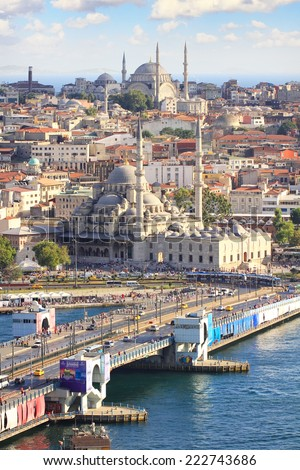 ISTANBUL - JUL 31, 2012: Galata Bridge is a bascule bridge which is 490 m long and connects Galata Coast to Eminonu Pier and Old City of Istanbul - stock photo