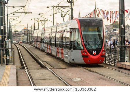 ISTANBUL - JULY 25 A modern tram on July 25, 2013 in Istanbul. Due to increasing traffic & air pollution, Istanbul became one of most polluted city also planned for return of tram. - stock photo