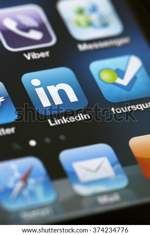 ISTANBUL - JULY 06, 2012: Apple Iphone 4S screen with social media applications of Linkedin, foursquare, Messenger and Viber. - stock photo