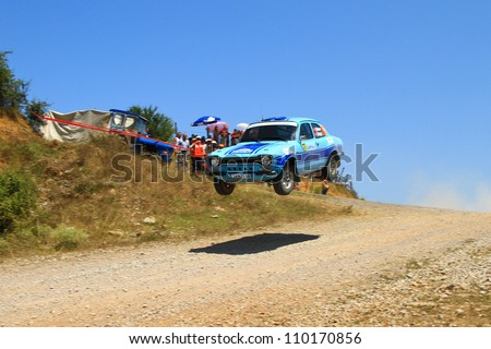 ISTANBUL - JULY 07: Erdal Tokcan drives a Ford Escort Mk1 car during 41st Bosphorus Rally ERC Championship, Halli Stage on July 7, 2012 in Istanbul, Turkey. - stock photo