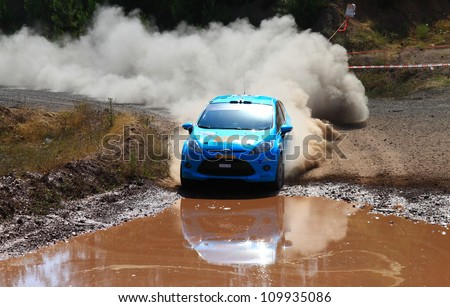 ISTANBUL - JULY 07: Ferhat Tanribilir drives a Ford Fiesta R2 car during 41st Bosphorus Rally ERC Championship, Gocbeyli Stage on July 7, 2012 in Istanbul, Turkey. - stock photo