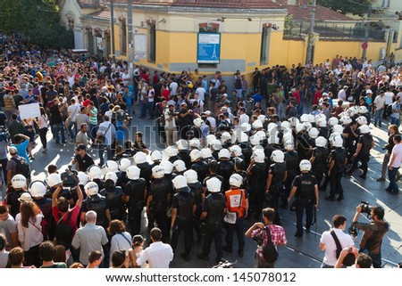 ISTANBUL - JULY 06: Police forces start interfere to protests in Istiklal Street on July 06, 2013 in Istanbul, Turkey. People are protesting the prohibition of entry to Gezi Park since 15 June 2013