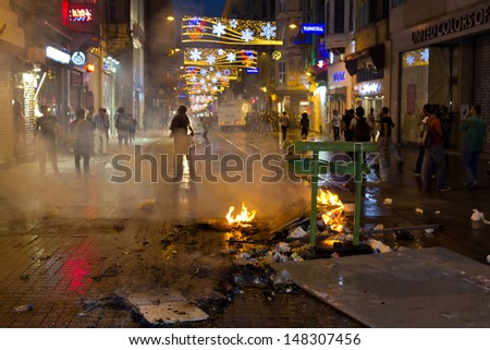 ISTANBUL - JULY 31: Riot Control Vehicle attack in Istiklal Street on July 31, 2013 in Istanbul, Turkey. People gathered and protest for Berkin Elvan who was shot in the head with a tear gas canister