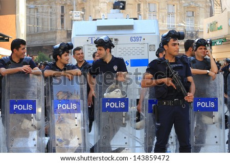 ISTANBUL - JUN 17: Five labor unions call 1-day nationwide strike over crackdown on June 17, 2013 in Istanbul, Turkey. Police lined up on Istiklal Street during the protest.