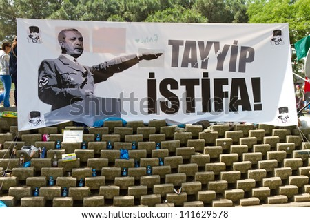 ISTANBUL - JUNE 08: A street banner in Gezi Park on June 08, 2013 in Istanbul, Turkey. Clashes are one of the most challenging events for Prime Minister Recep Tayyip Erdo���°an's ten-year rule